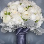 bridal bouquet on blue silk chair- wedding photo by top Canadian wedding photographer Rebecca Wood