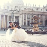 the happy couple kissing in Roman square - wedding photo by top Rome based destination wedding photographer Rochelle Cheever, Rome Weddings Photography