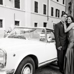 the happy couple standing by car - wedding photo by top Rome based destination wedding photographer Rochelle Cheever, Rome Weddings Photography