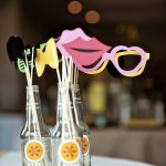 party favors sit in bottles on a table - wedding photo by top Atlanta based wedding photographers Scobey Photography