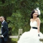 bride and groom posing on fence - wedding photo by top Atlanta based wedding photographers Scobey Photography