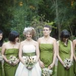 bride and bridesmaids in chartreuse laugh while posing for photos - wedding photo by top Atlanta based wedding photographers Scobey Photography