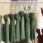 sage green bridesmaids dresses, white flower girl dress and dark pink maid of honor dress hanging - sweet southern military style wedding photo by Charleston wedding photographer Virgil Bunao
