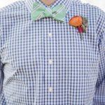 groomsmen dressed in blue gingham shirt with striped green bow tie, photo by Taylor Lord Photography