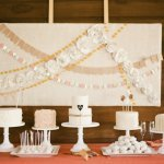 dessert table with cakes and paper flower garlands, photo by Taylor Lord Photography