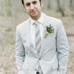 groom in grey suit with striped grey tie, photo by Erich McVey Photography