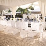 white tented reception seating, photo by Melissa Jill Photography