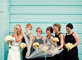 laughing bride and bridesmaids wedding photo by Dan Stewart Photography