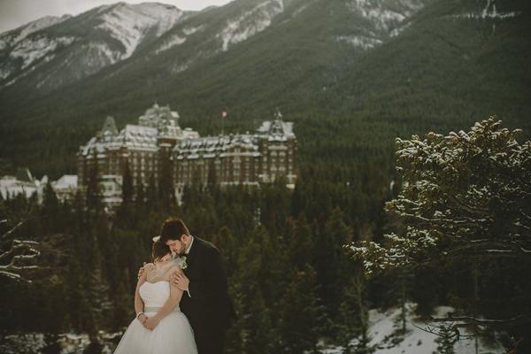 white and gold winter wedding at Fairmont Banff Springs, photo by Gabe McClintock | via junebugweddings.com