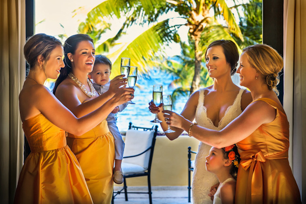 cheers with the bridesmaids, photo by Zasil Studio | via junebugweddings.com