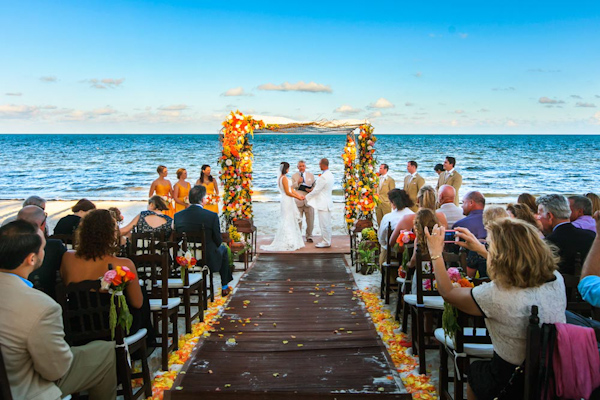 colorful beach wedding ceremony, photo by Zasil Studio | via junebugweddings.com