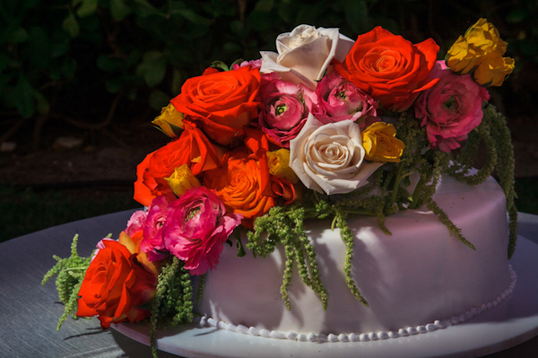 colorful floral wedding cake, photo by Zasil Studio | via junebugweddings.com