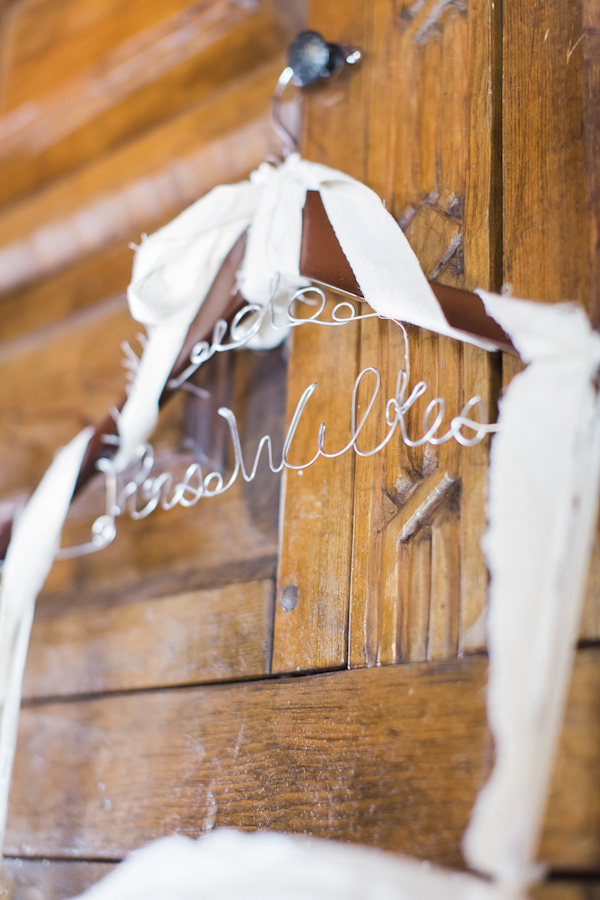 personalized wedding dress hanger, photo by Rachel Solomon | via junebugweddings.com