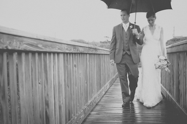 wedding portrait in the rain, photo by Still55 Photography | via junebugweddings.com