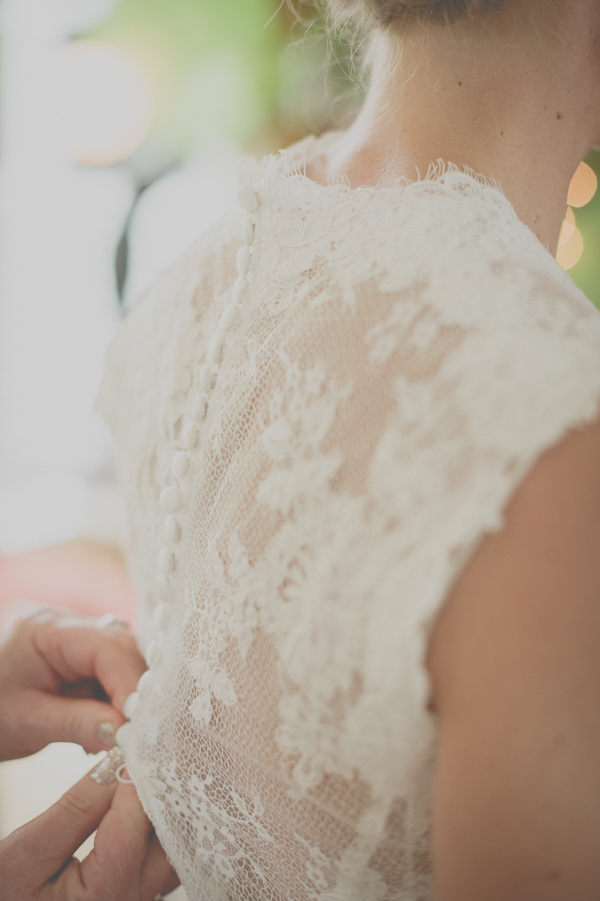 lace wedding dress by Allure Bridals, photo by Still55 Photography | via junebugweddings.com