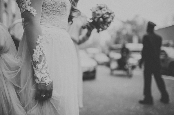 detailed lace sleeve wedding dress and bouquet