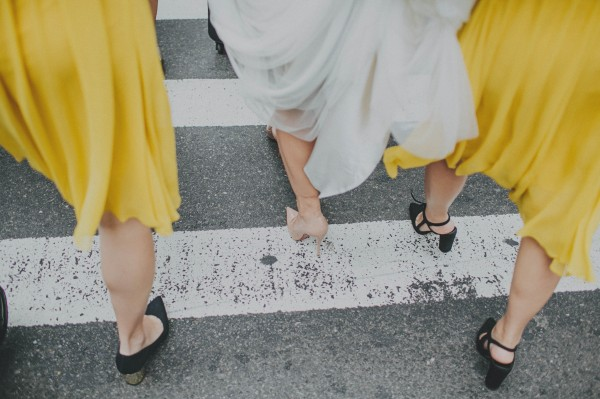 bride and bridesmaids' shoes in the city