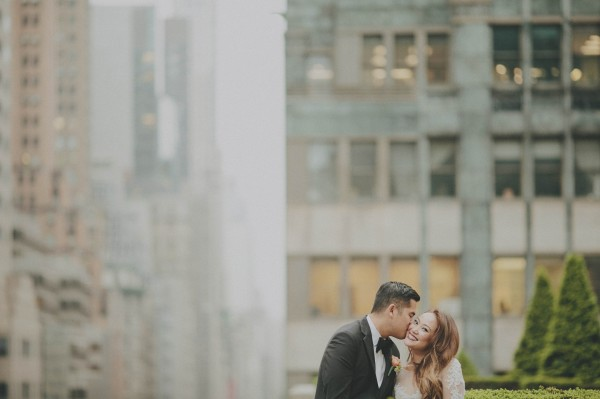 adorable kiss on the cheek couple's portrait