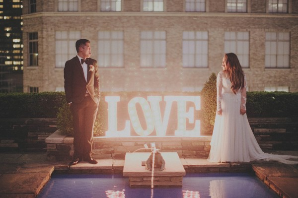 couple's portrait with love marquee sign
