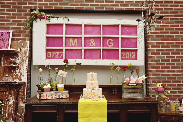 pink and yellow wedding dessert table