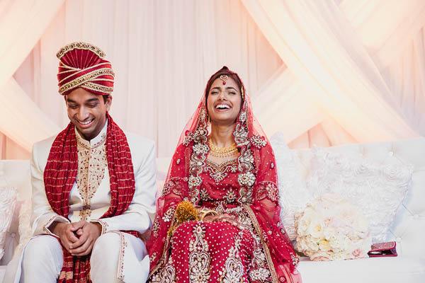 traditional Indian wedding couple laughing