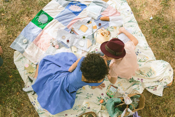 same-sex couple wedding picnic blanket dining