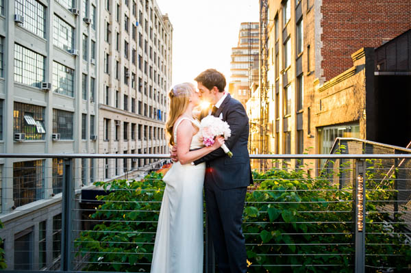 beautiful kiss shot in the city with the sun
