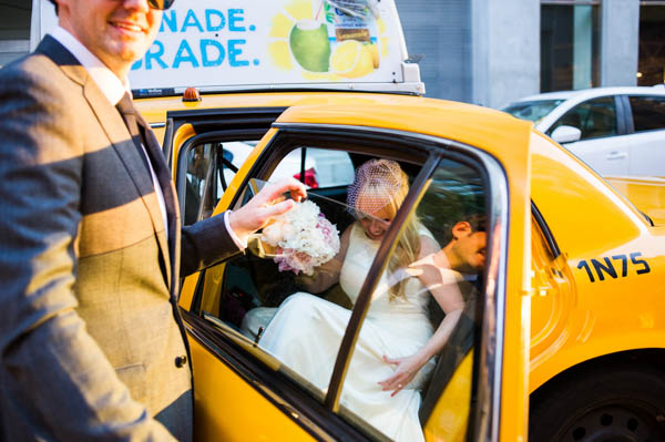 New York bride getting into a taxi