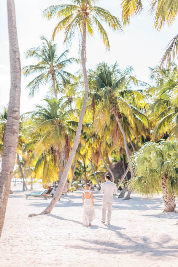 intimate beach wedding couple's space, photo by Chris Glenn | via junebugweddings.com