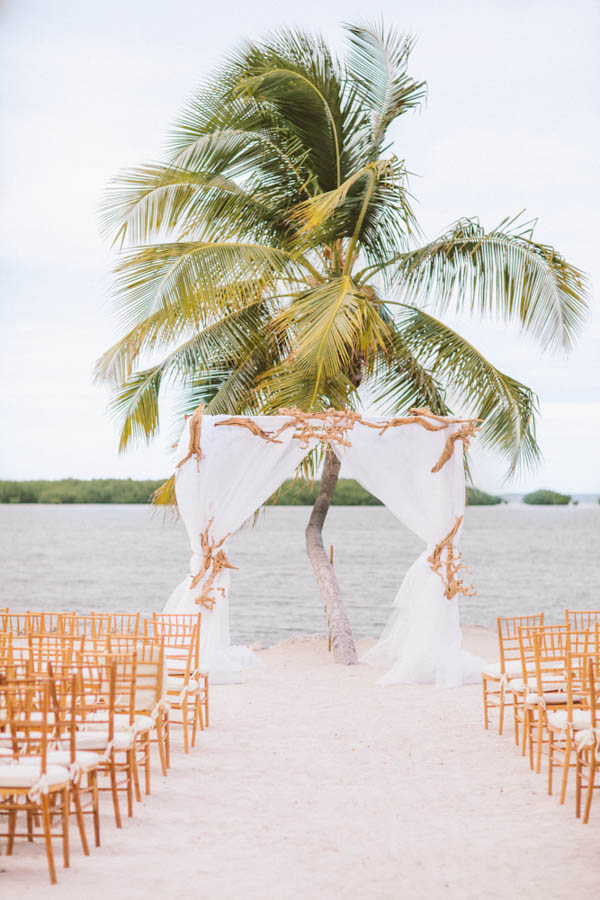 intimate beach wedding ceremony portrait, photo by Chris Glenn | via junebugweddings.com