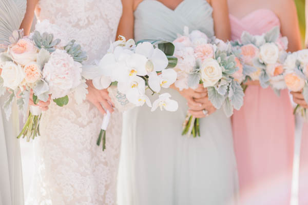 intimate beach wedding ceremony bridesmaid bouquets, photo by Chris Glenn | via junebugweddings.com