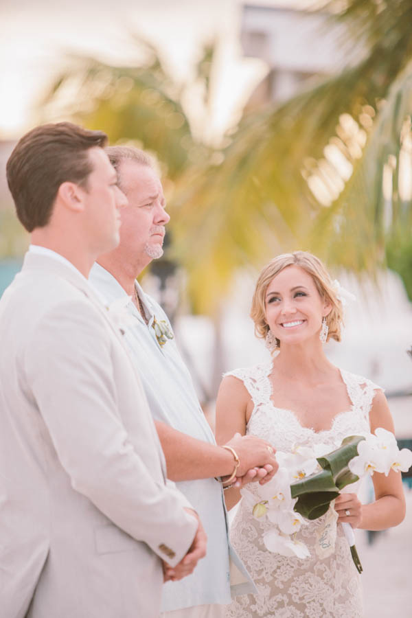intimate beach wedding ceremony, photo by Chris Glenn | via junebugweddings.com