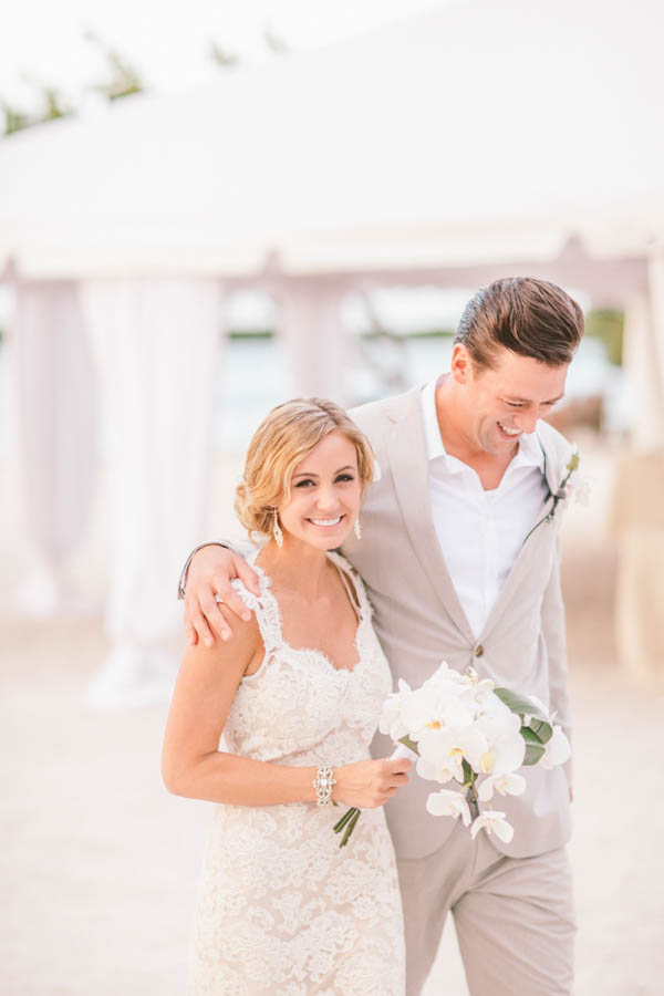 intimate beach wedding couple's portrait, photo by Chris Glenn | via junebugweddings.com