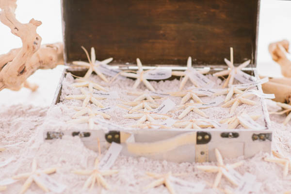 intimate beach wedding starfish decor, photo by Chris Glenn | via junebugweddings.com