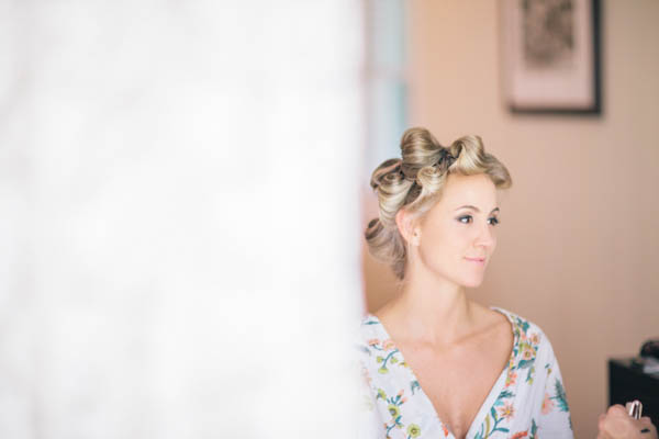 bride getting ready, photo by Chris Glenn | via junebugweddings.com