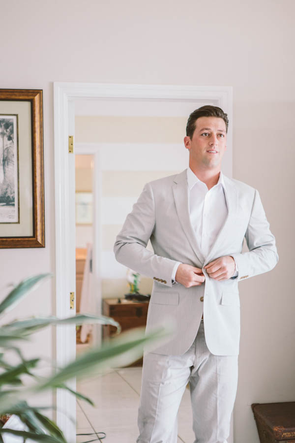 groom getting ready, photo by Chris Glenn | via junebugweddings.com