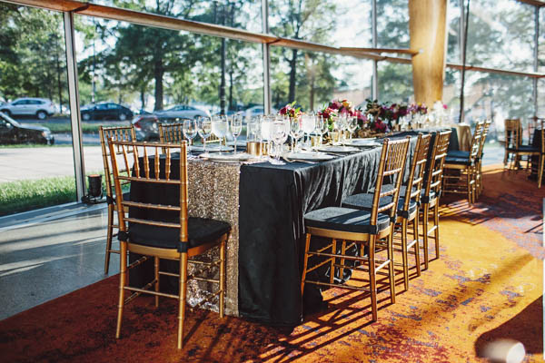 beautiful wedding reception table and gold chairs