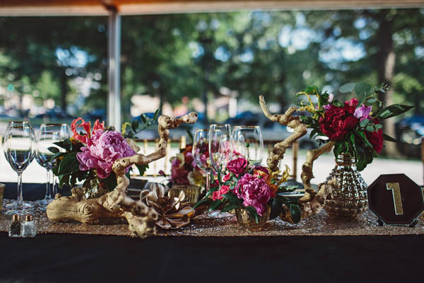 sequin table runner and vibrant floral decor