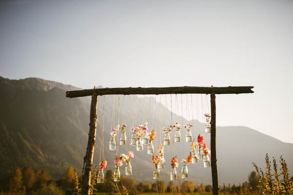 gorgeous hanging floral ceremony arch