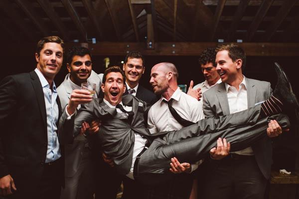 groom and his groomsmen reception fun