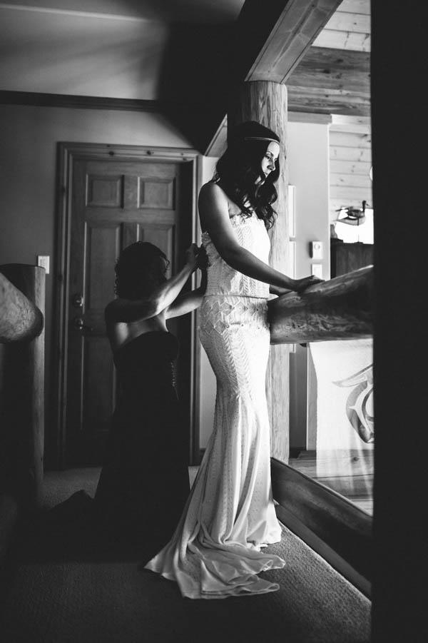 elegant bride getting dressed portrait
