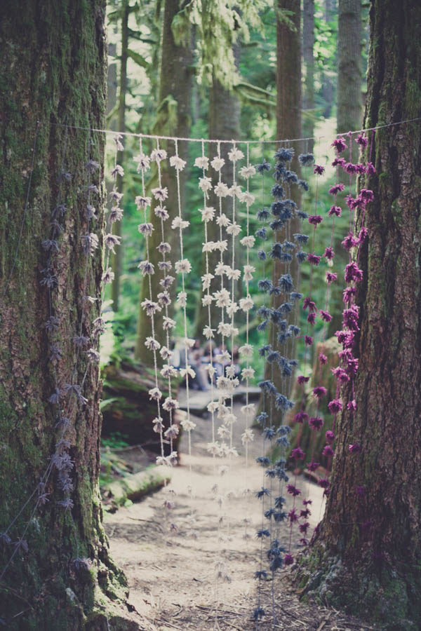 romantic camp wedding ceremony hanging floral decor
