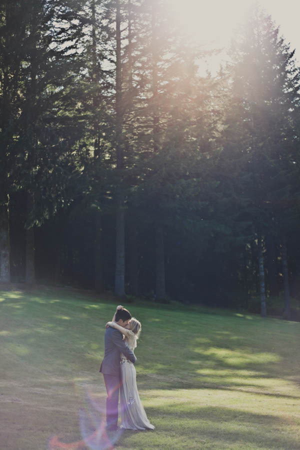 couple's portrait with tall trees