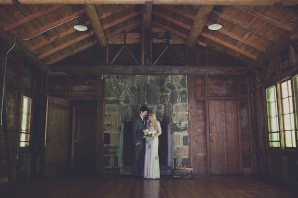romantic couple's portrait in a cabin with fireplace