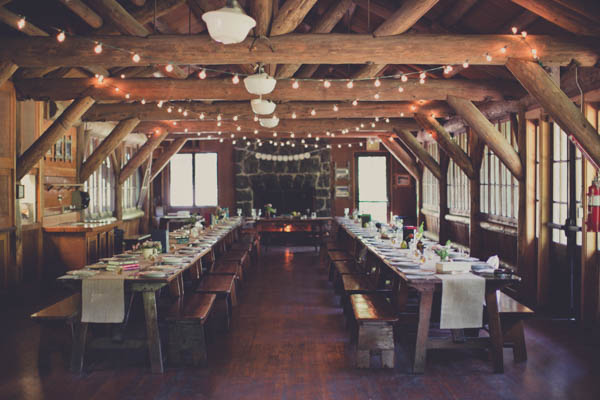 romantic camp wedding reception decor with lights