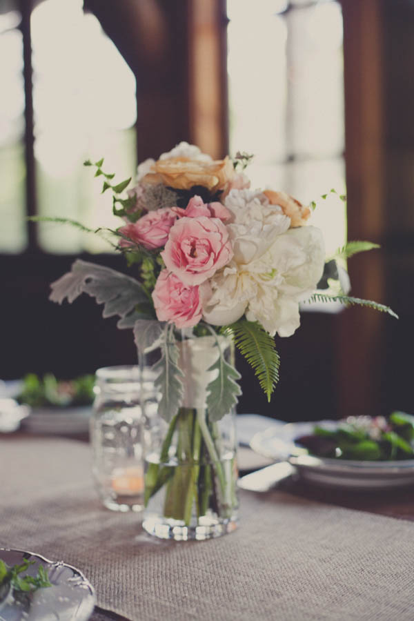 romantic light pink, orange, and ivory wedding reception flowers