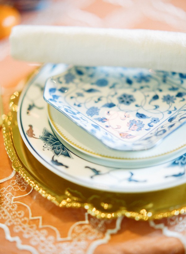 gold and blue table setting