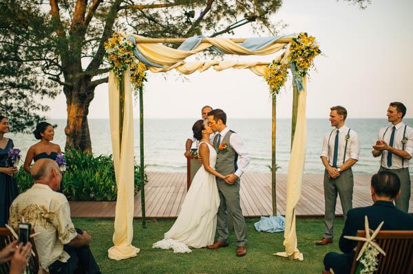 Thailand destination wedding ceremony kiss