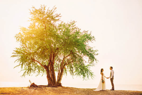 beautiful couple's portrait with tree
