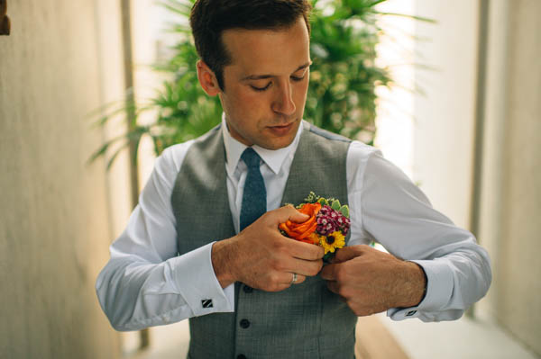 groom's vibrant boutonniere